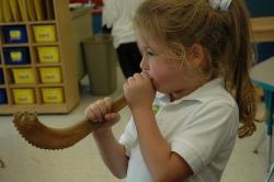 girl blowing shofar